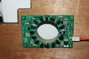 One of the broken coin detection boards - I later found the torn-off capacitor in the coin bin.